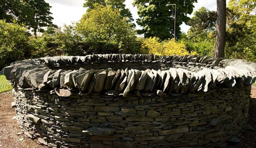 """Slate, Hole, Wall"" by Andy Goldsworthy: a  circular stone wall"